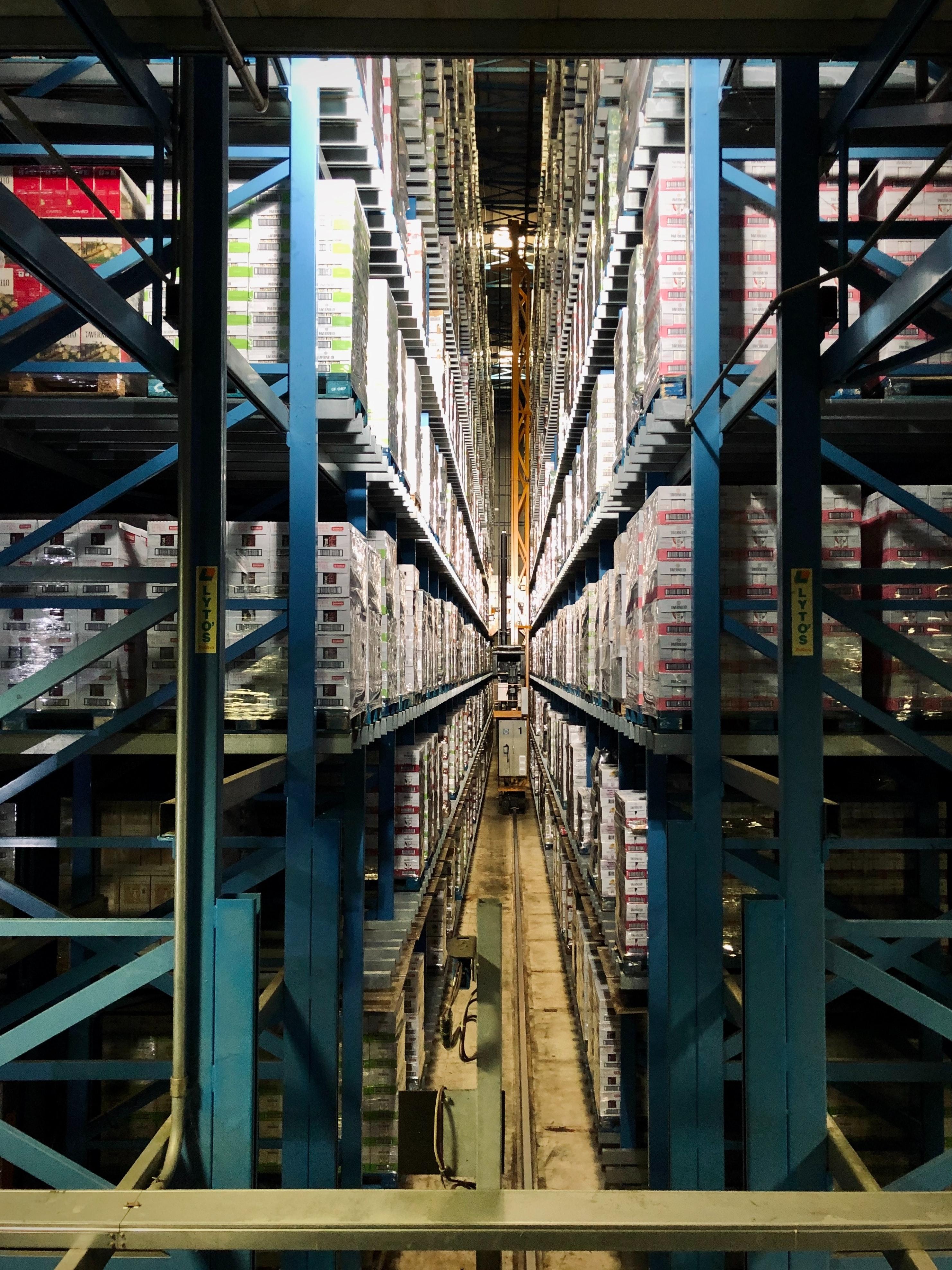 full pallets stacked on blue warehouse racks